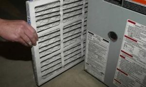 installing furnace filter into furnace