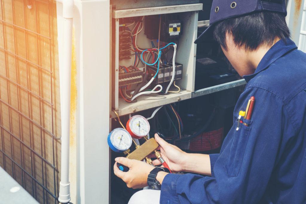 Man repairs HVAC unit