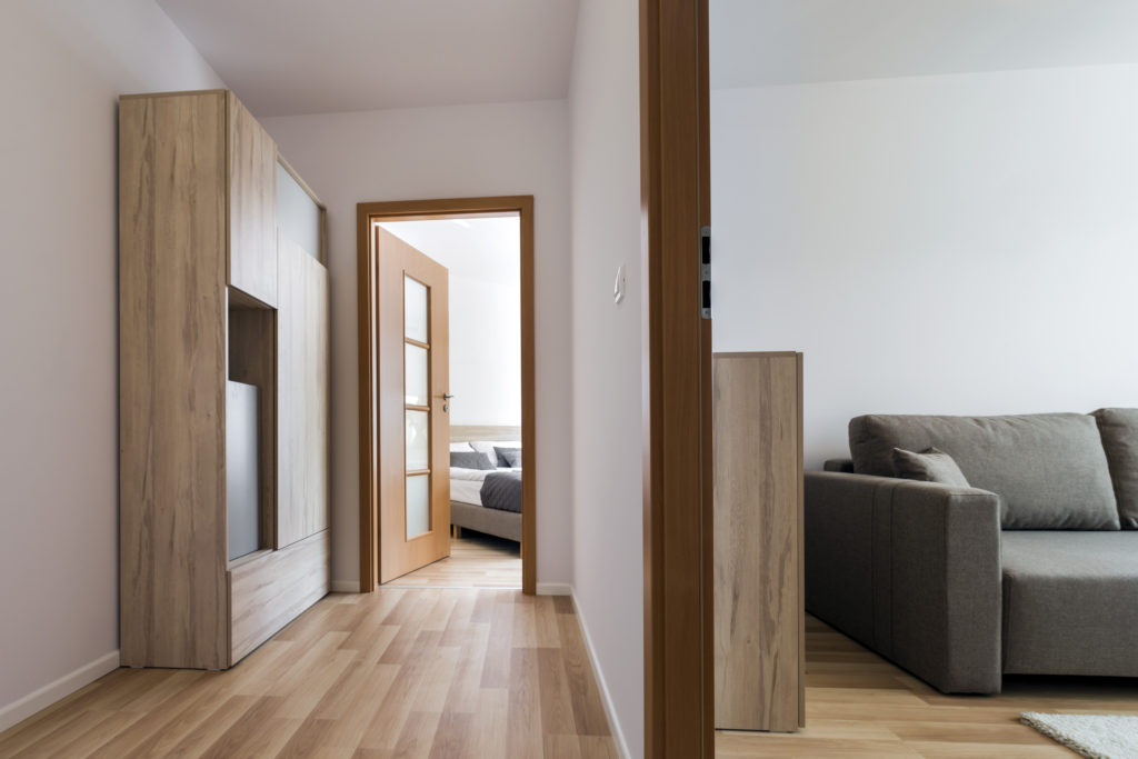 two modern rooms in house with wood