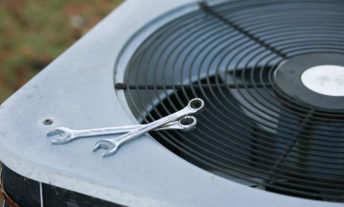 Air conditioner with tools ready for repair