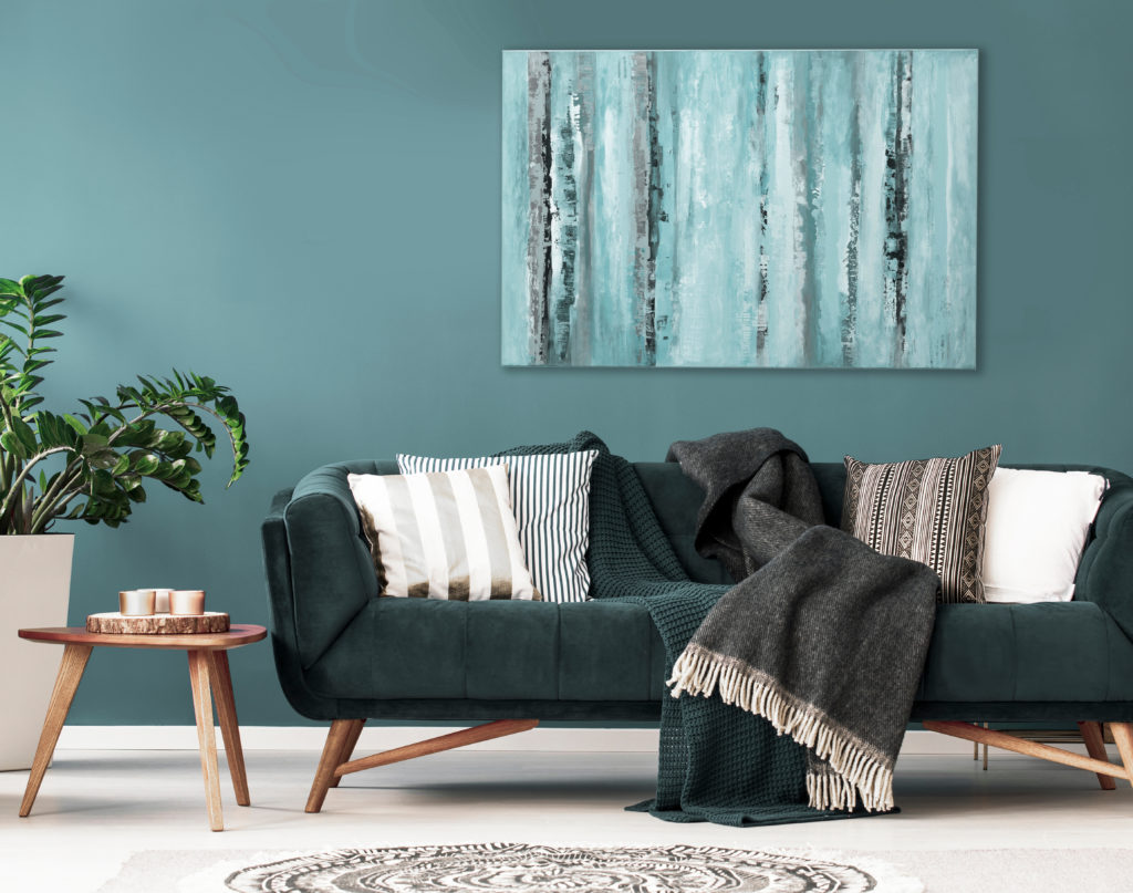 living room with green couch and blue wall
