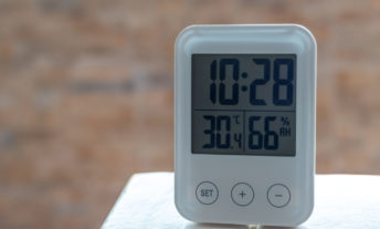clock with humidity sensor on table