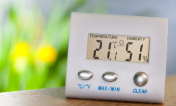 Hygrometer shows indoor temperature and humidity level