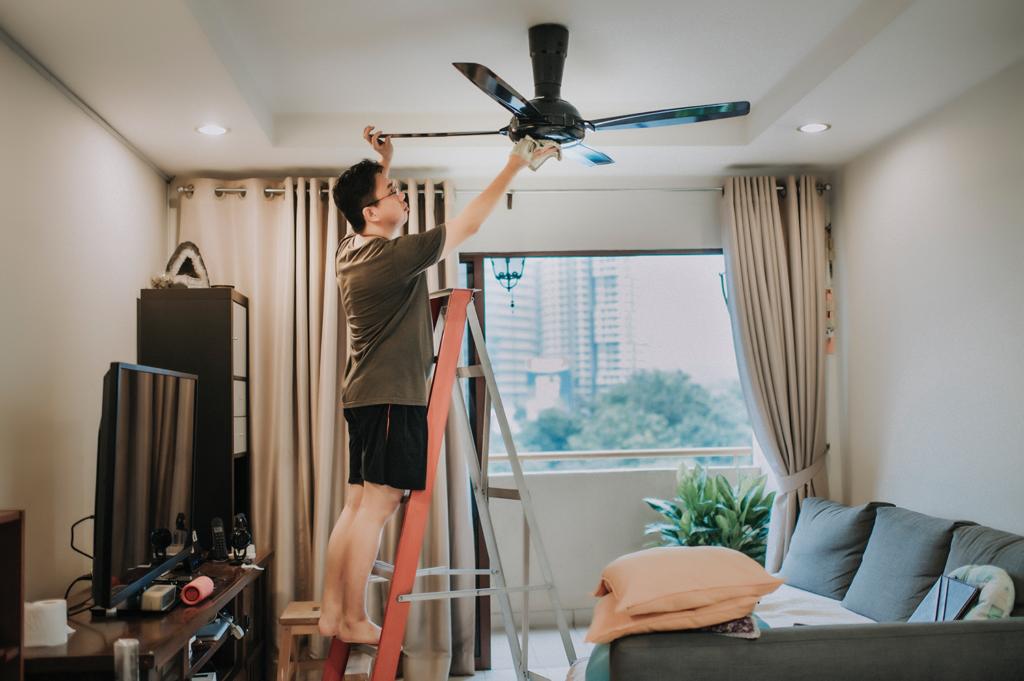 man-repairing-ceiling-fan