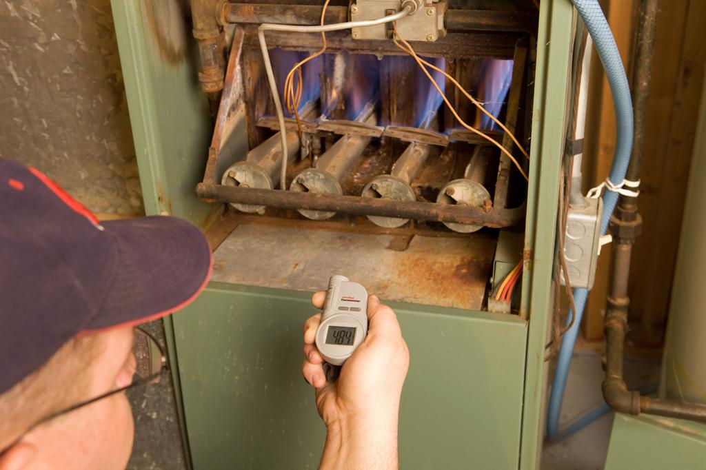 man-turning-on-furnace